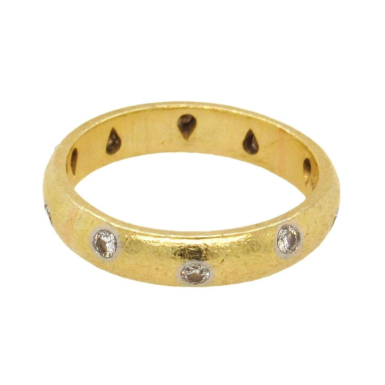 18K gold and platinum hammered texture 'Etoile' band from Tiffany & Co, size 6.5, is the design standard for a classic contemporary band, the 4mm bombé band studded with 10 platinum bezel-set diamonds, 0.50 cts tw. Hallmarked Tiffany & Co, from an