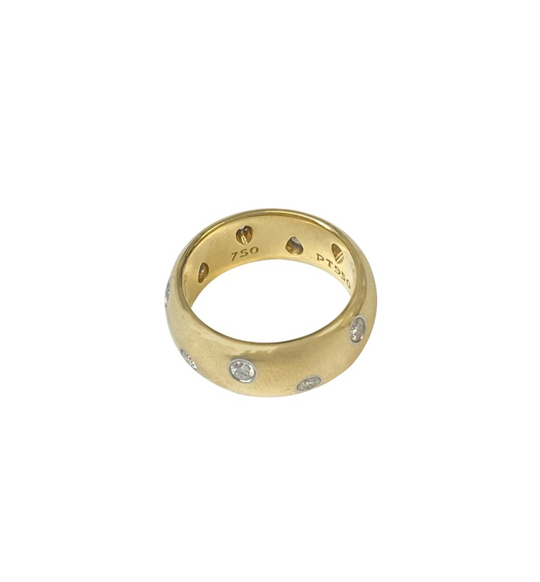 Circa 2005 Tiffany & Company Etoile collection 18k Yellow Gold and Platinum Band Ring, measuring 7.5 M.M. wide this is the widest / largest of the Etoile Band Rings, set with 10 Round Brilliant cut Diamonds totaling .40 Carat and Grading as G in