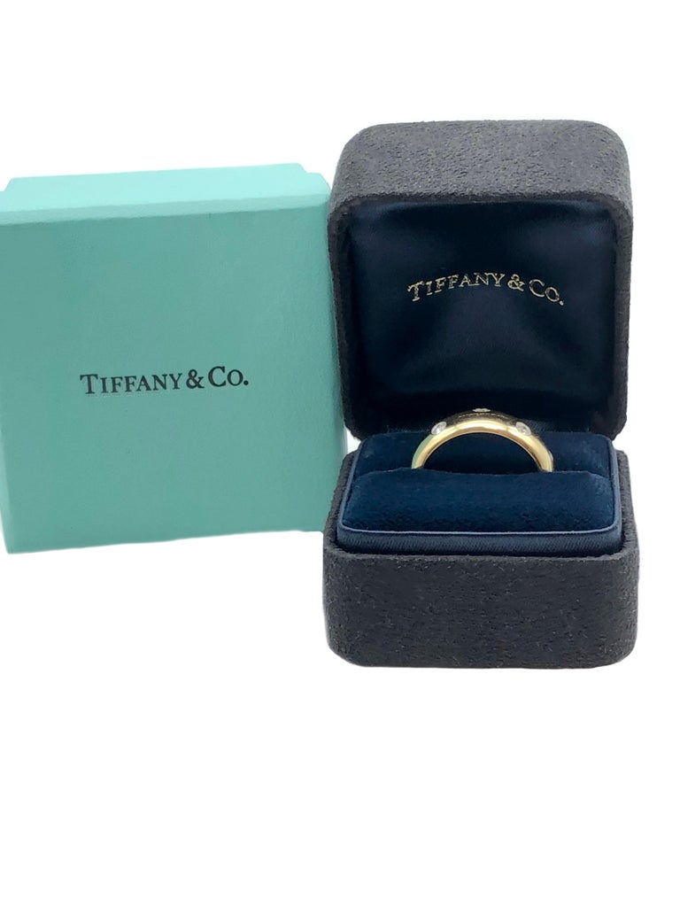 Tiffany & Co. Etoile Gold Platinum and Diamond Wide Band Ring In Excellent Condition For Sale In Chicago, IL