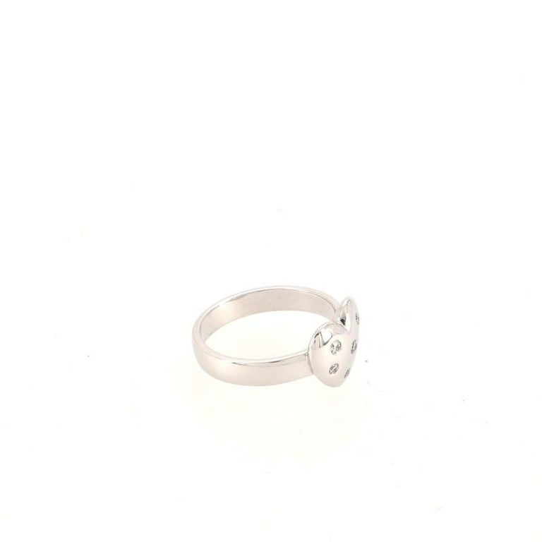 Condition: Very good. Shows signs of moderate wear throughout. Accessories: No Accessories Measurements: Size: 5 Designer: Tiffany & Co. Model: Etoile Heart Ring 18K White Gold and Diamonds 18K White Gold and Diamonds Exterior Material: 18K White