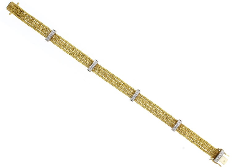 From Tiffany & Co. a four stand 18 karat gold bracelet with diamonds ♦ Designer: Tiffany & Co. ♦ Metal: 18 karat ♦ 25 Diamonds=.30 ♦ Circa 1980s ♦ 7 1/4inches, 3/8 of and inch wide ♦19.5 grams ♦ Condition: Excellent , pre-owned ♦ Price: Based on the