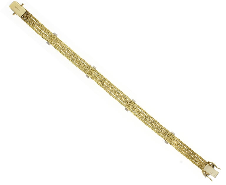 Tiffany & Co. Four-Stand Gold and Diamond Bracelet In Good Condition For Sale In Bethesda, MD