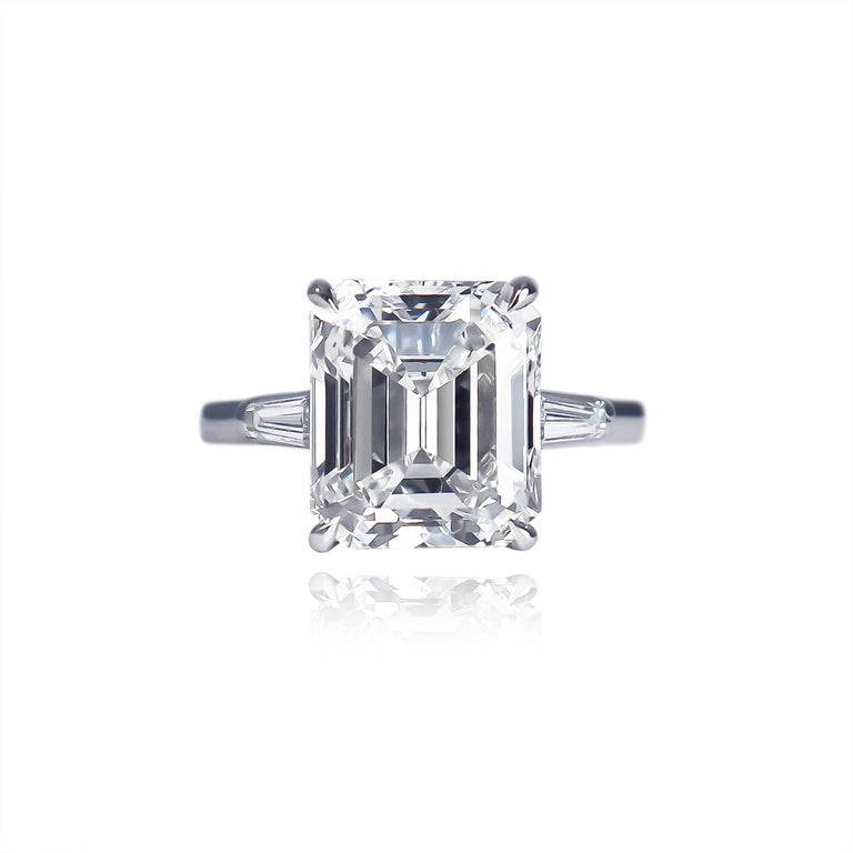 This breathtaking, platinum, Tiffany & Co. ring features a GIA certified 5.25 carat emerald cut diamond of E color and VS2 clarity. Set in a signed ring with tapered baguettes = approximately 0.40 carat total weight, this piece is a contemporary