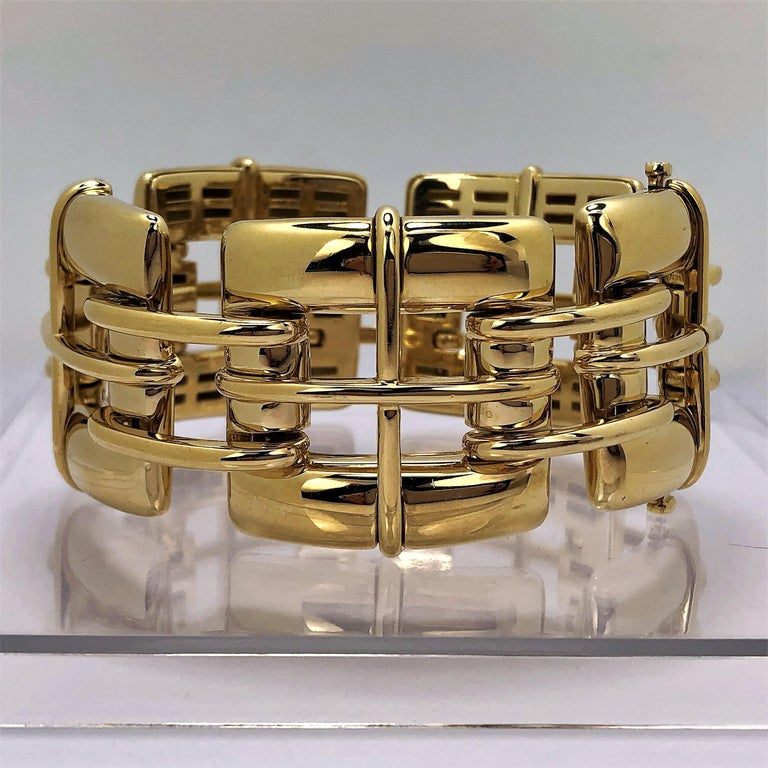 One ladies 18 karat yellow gold Biscayne model bracelet by Tiffany & Co measuring  1 1/4 inches  wide and 7 1/2 inches long. This stylish bracelet is comprised of five 1 1/4 inch by 1 1/4 inch open links connected by two curved horizontal links.