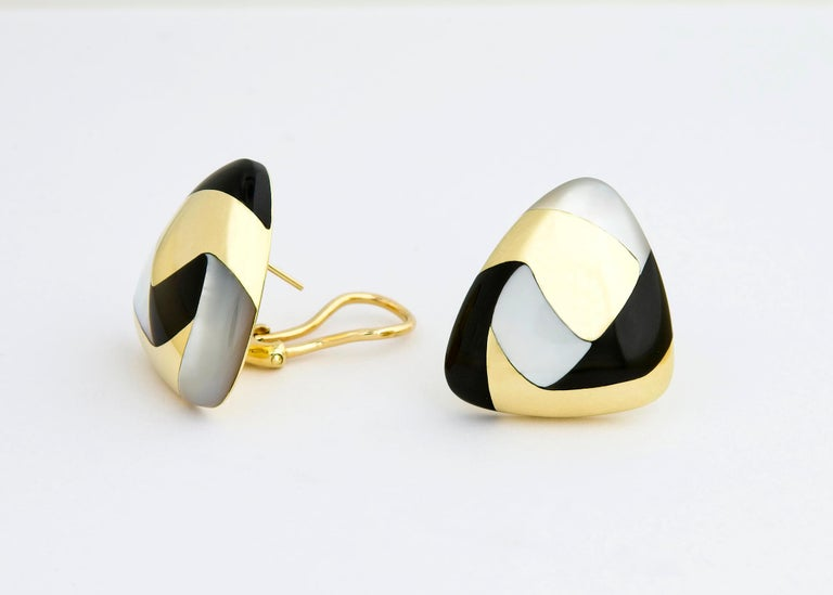 Tiffany & Co. uses Mother of Pearl and Black Jade to create a beautiful contrast in this easy to wear soft flattering shaped earring. 7/8's of an inch in size.