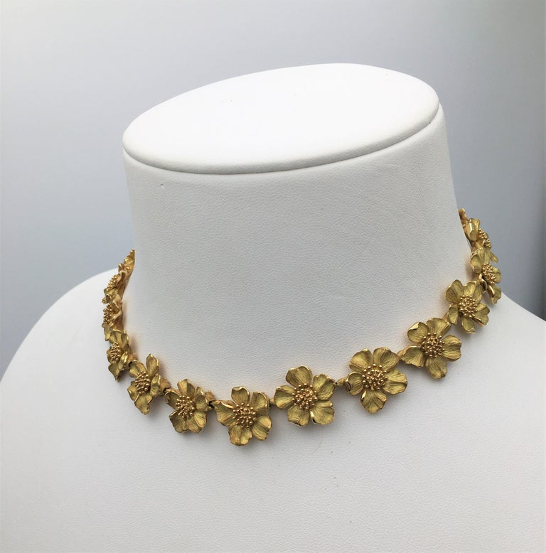 Authentic classic Tiffany & Co. Dogwood flower link necklace crafted in textured 18 karat yellow gold. Signed Tiffany & Co., Tiffany Classics, 750. The necklace measures 16 inches in length. Presented with original pouch, no box or papers. CIRCA