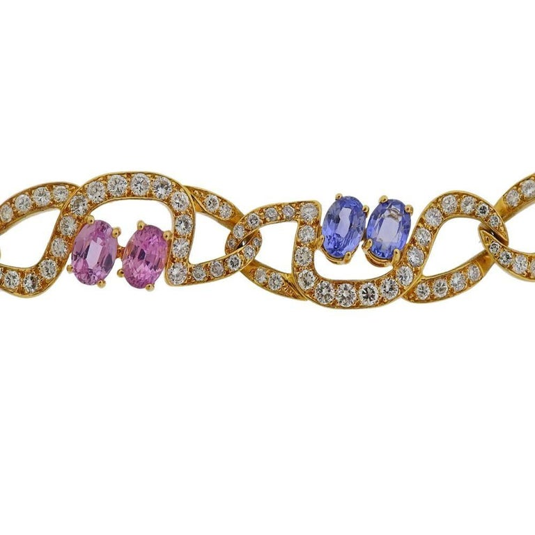18k gold bracelet by Tiffany & Co, set with approx. 6.00-6.50ctw in diamonds and 4 yellow, 4 pink and 4 blue sapphires - each stone approx. 0.80-0.85cts, total approx. 10cts +.  Marked Tiffany & Co. Bracelet is 7.25