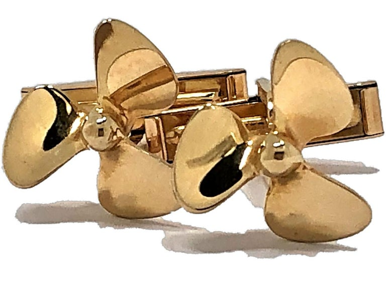 Made by Tiffany & Co, these 14K Yellow Gold Cufflinks in the shape of propellers are ideal for any man who is an avid boater. The fold down backs make them easy to put on and to take off. Stamped TIFFANY & CO 585. The propellers measure 5/8 inch