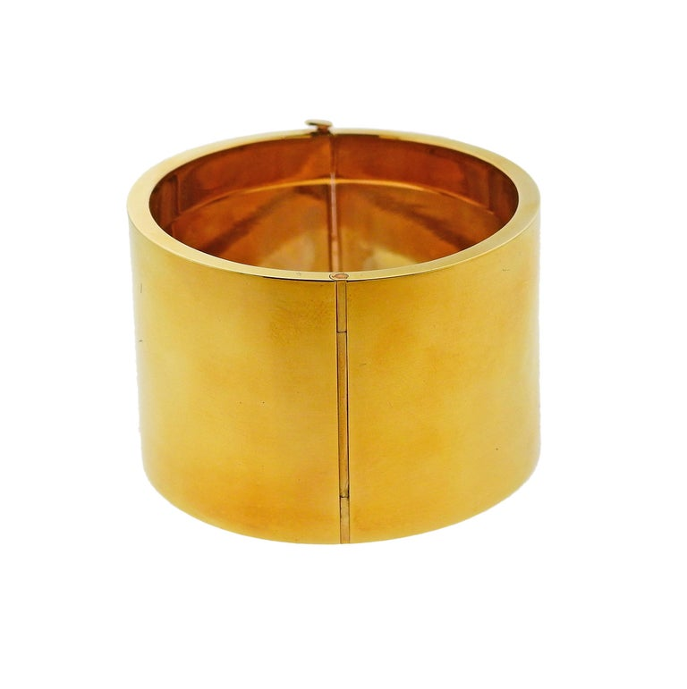 Wide 14k yellow gold bangle bracelet by Tiffany & Co. Comes with original box.  Bracelet will fit approx. 7