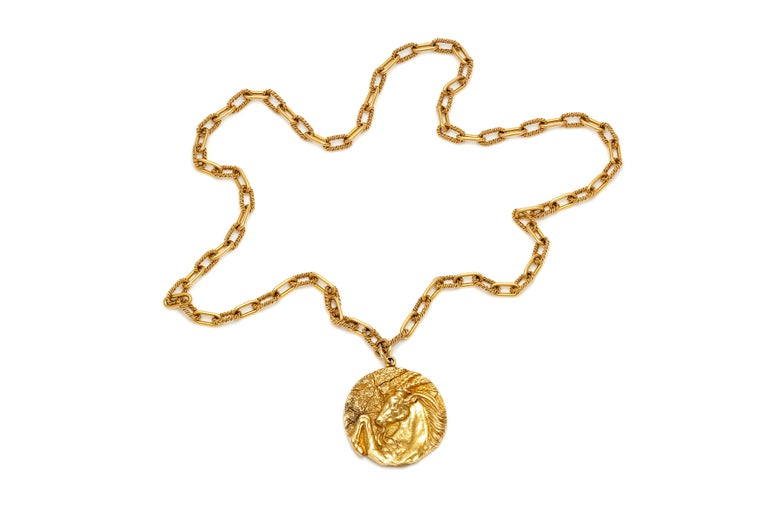 Tiffany & Co. necklace, finely crafted in 18k yellow gold with zodiac pendant. Circa 1970's.