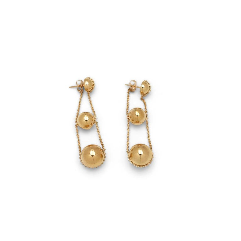 Authentic Tiffany & Co. 'Triple Drop' earrings from the HardWear collection crafted in high polished 18 karat yellow gold. Comprised of 3 spheres suspended by a fine linked chain, the earrings have a jacket closure with the earring back attached to
