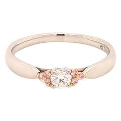 Tiffany & Co. Harmony Diamond, Fancy Pink Diamond Side Stone Platinum Ring