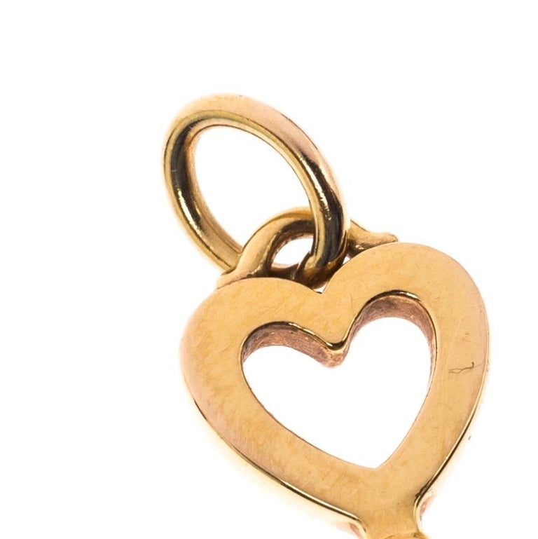 This Tiffany & Co. pendant is shaped like a key using 18k yellow gold and it has a heart-shaped bow. Like all of the other keys from Tiffany, this pendant also symbolizes a shining future.  Includes: Original Dustbag, Original Box