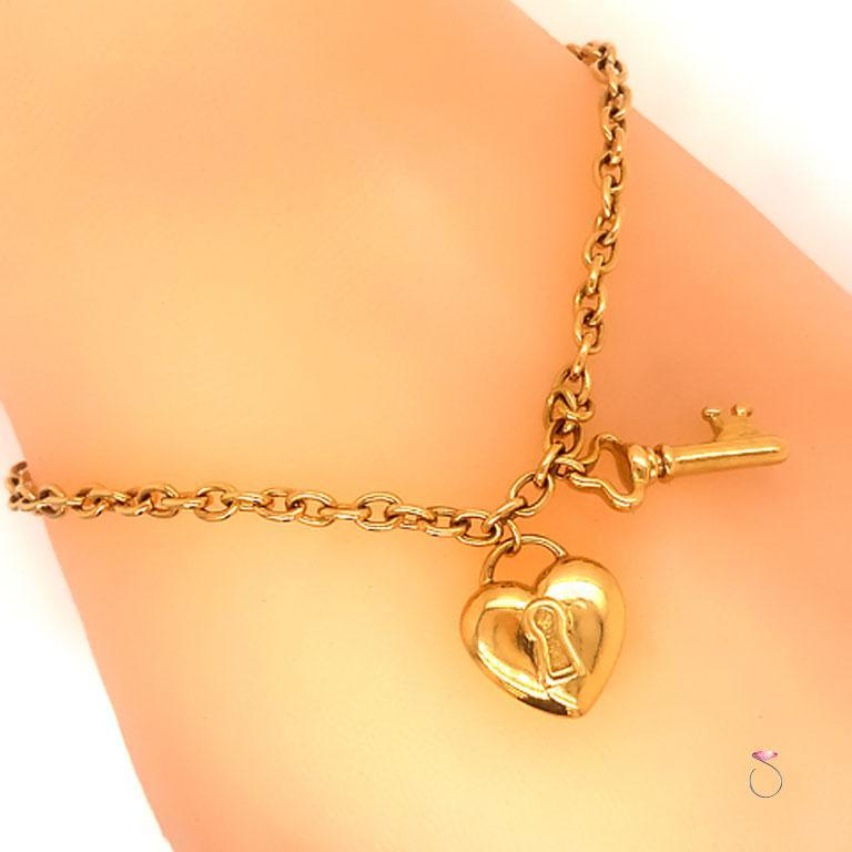 Tiffany & Co. Heart & Key Charm Bracelet in 18K Yellow Gold In Good Condition For Sale In Honolulu, HI