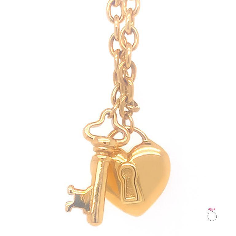 Tiffany & Co. Heart & Key Charm Bracelet in 18K Yellow Gold For Sale 2