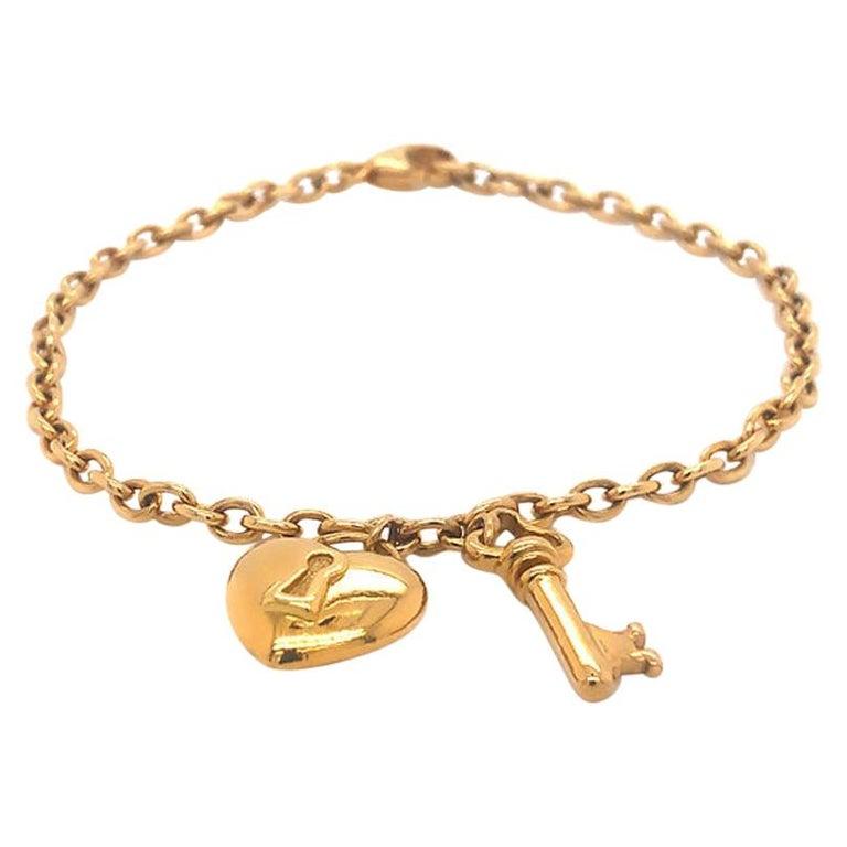 Tiffany & Co. Heart & Key Charm Bracelet in 18K Yellow Gold For Sale