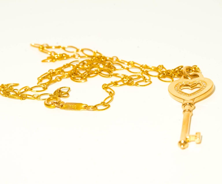 Tiffany & Co. Heart Key pendant with Diamonds and 20 inch oval link chain in 18K Yellow Gold Key is Medium size ( 1.5 Inches) and in excellent condition  with original Box and Bag