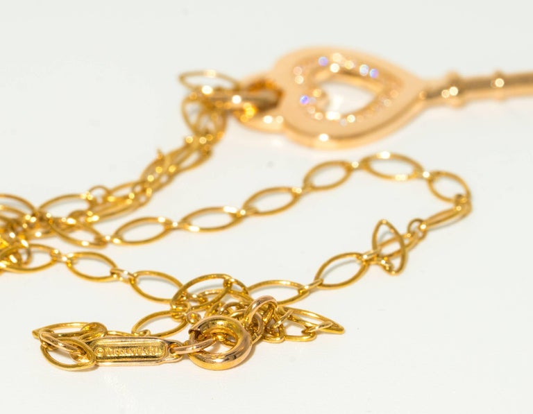 Contemporary Tiffany & Co. Heart Key Pendant with Diamonds and Chain in 18 Karat Yellow Gold For Sale
