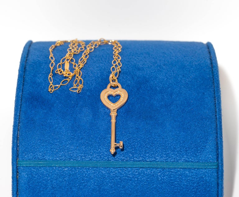 Round Cut Tiffany & Co. Heart Key Pendant with Diamonds and Chain in 18 Karat Yellow Gold For Sale