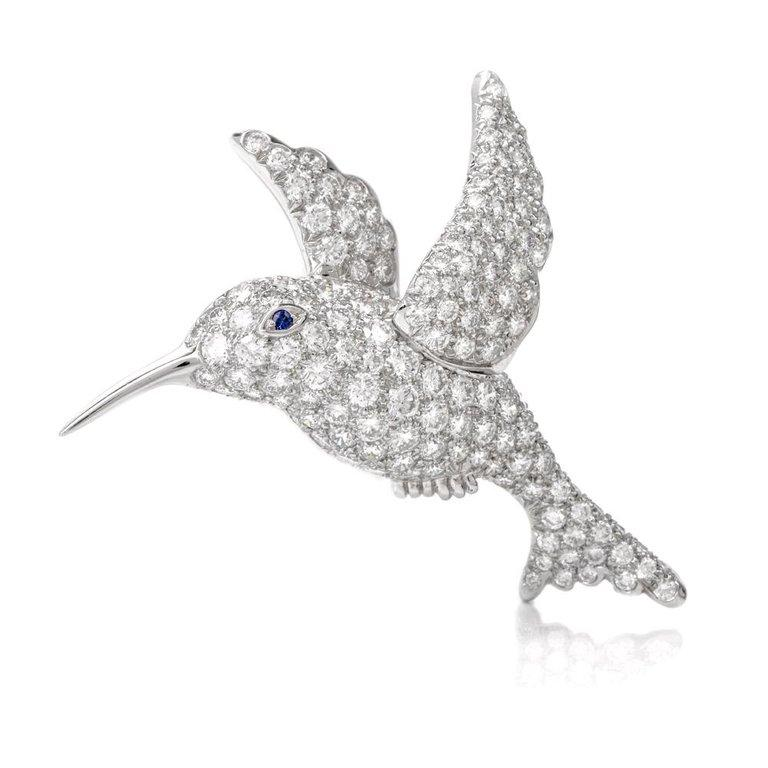 This Tiffany & Co. brooch pin is crafted in solid platinum, weighs 12.7 grams and measures 1.6 inches x 1.5 inches. Depicting a fanciful sculptured profile of a hummingbird, the delicate pin brooch is pave-set with 3.00 carats of high quality