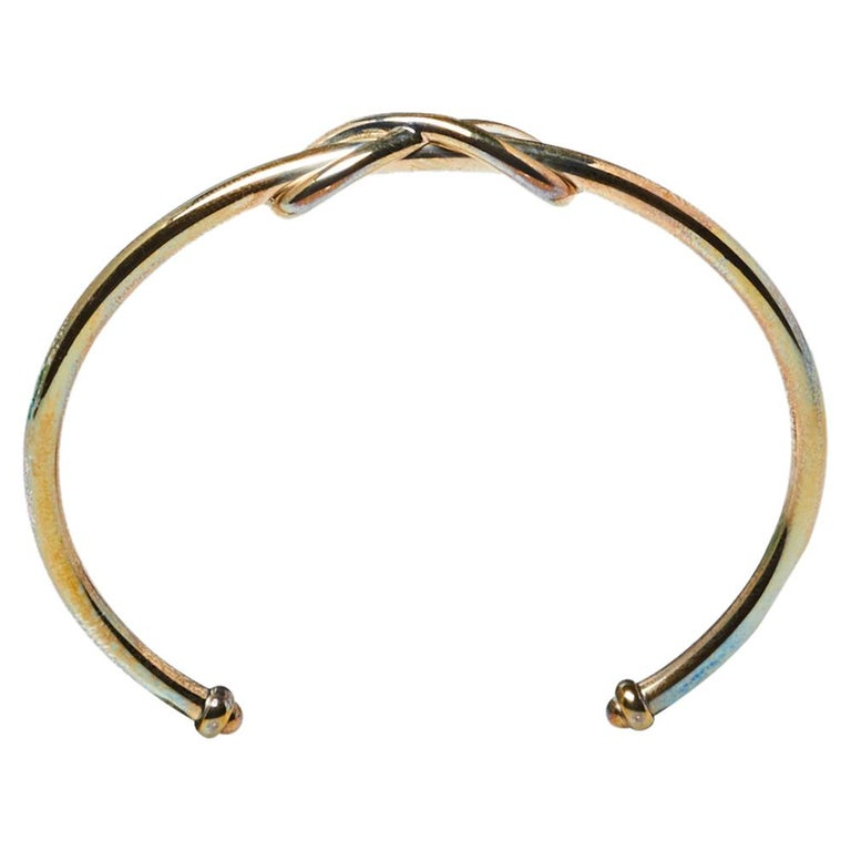 Define your delicate wrist by wearing this open cuff bracelet from Tiffany & Co. This silver band is simply fashioned with the infinity design at the center of the smooth band. This lovely piece can be accessorized with a formal or casual