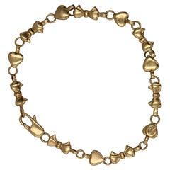 Tiffany & Co. Italy 18 Karat Heart and Bowtie Motif Link Bracelet