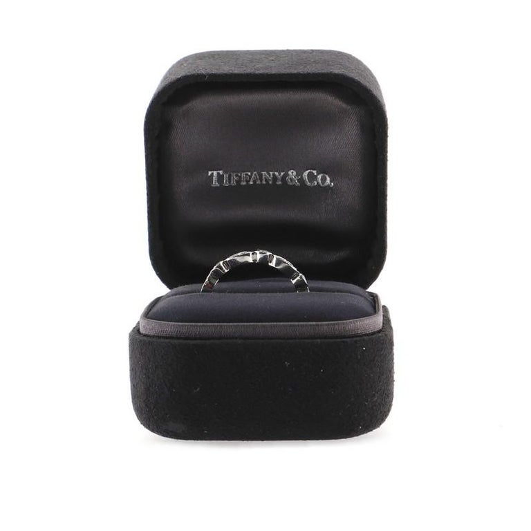 Estimated Retail Price: $4,700 Condition: Great. Minor wear throughout. Accessories: No Accessories Measurements: Size: 7.5 Designer: Tiffany & Co. Model: Jazz Swing Ring Platinum with Diamonds Exterior Color: Silver Item Number: 80404/17