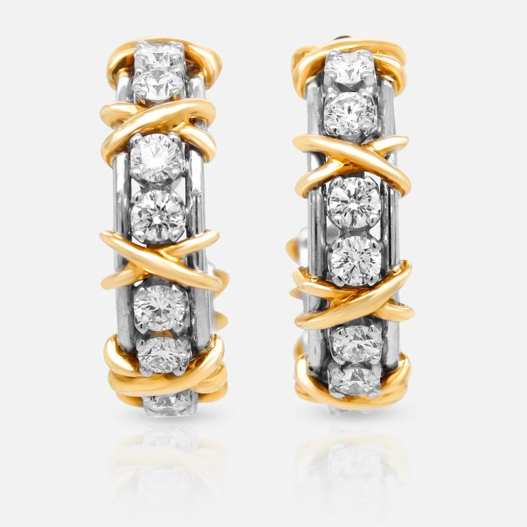 Tiffany & Co. Jean Schlumberger 18K White Gold Platinum Diamond X Hoop Earrings  Diamonds are set in platinum and topped with 18k gold X's.  1.80 carat G color, VS clarity diamonds.  Retail $16,000  1 inch hoops. 5.5mm width.  Signed Jean