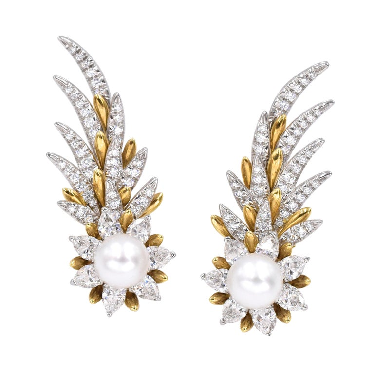 Rare  Tiffany and  Co, Jean  Schlumberger Flame Ear Clip On  Center pearl surrounded by 7 pear shaped diamonds. Diamond encrusted platinum and gold flame  feathers. Signed: Tiffany and Co (Jean Schlumberger)