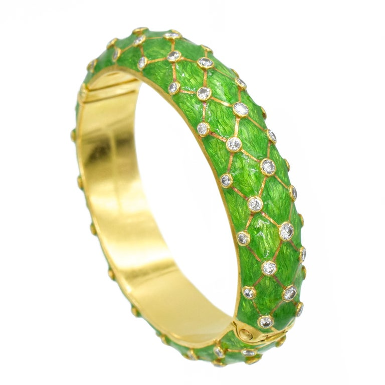 Tiffany & Co. Gold, Green Enamel and Diamond Bangle Bracelet This bangle bracelet has the bombé bangle applied with patterned apple green enamel, continuously set with diagonal rows of 85 collet-set round diamonds ap. 3.20 cts., joined by