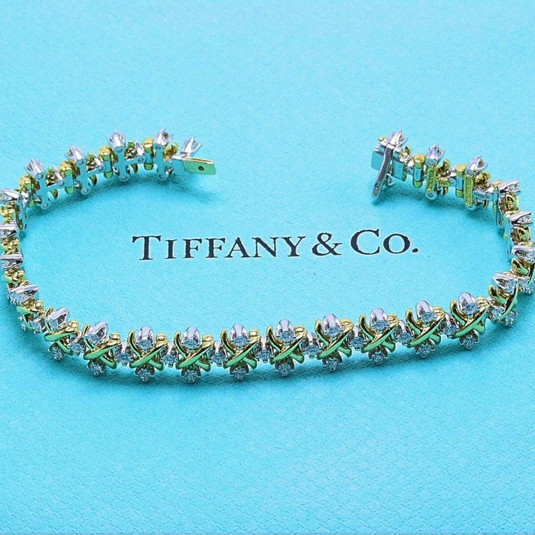 Tiffany & Co  Jean Schlumberger Lynn Diamond Bracelet in 18KT Yellow Gold and Platinum.   Length is 7 Inches with Clasp Closure.   There are 75 Round Full Cut Diamonds 2.77 TCW D - G color, VVS - VS clarity.   Hallmarked