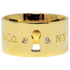 Tiffany & Co. Keyhole 18 Karat Yellow Gold Wide Band Ring with Diamonds
