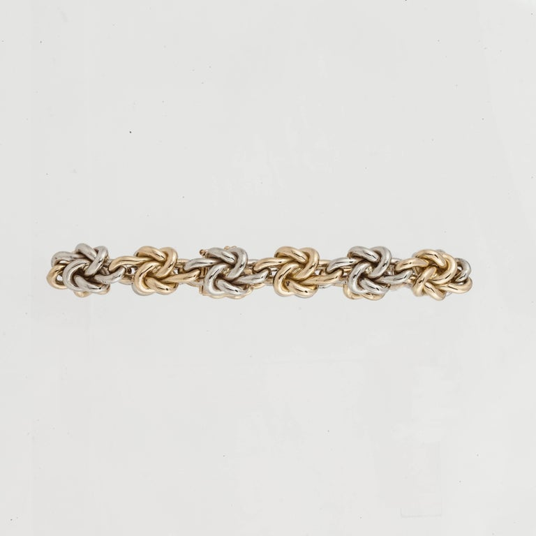 18K bracelet made by Tiffany & Co.  It is both white and yellow gold with alternating knots.  Measures 7-1/2