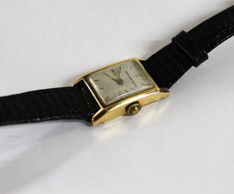Elegant vintage Tiffany & Co. manual wind dress watch made with 18-karat yellow gold. It is slender and has a soft rectangular design.