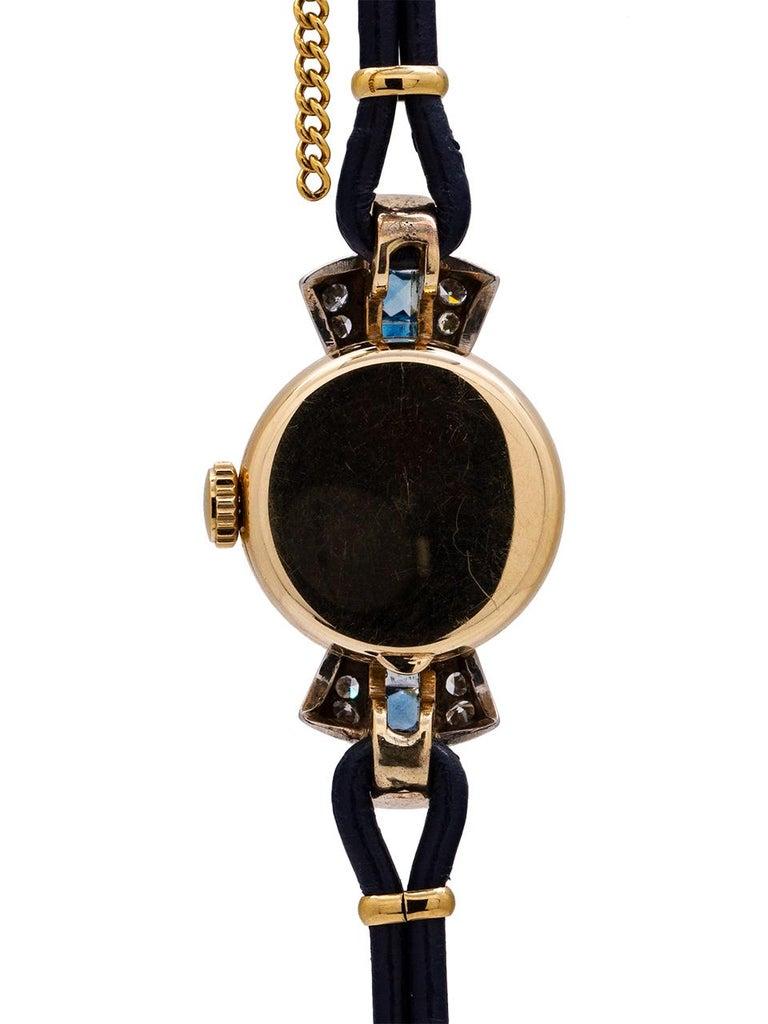 Round Cut Tiffany & Co. Lady's 14 Karat Yellow Gold Sapphire and Diamond Watch circa 1940s For Sale