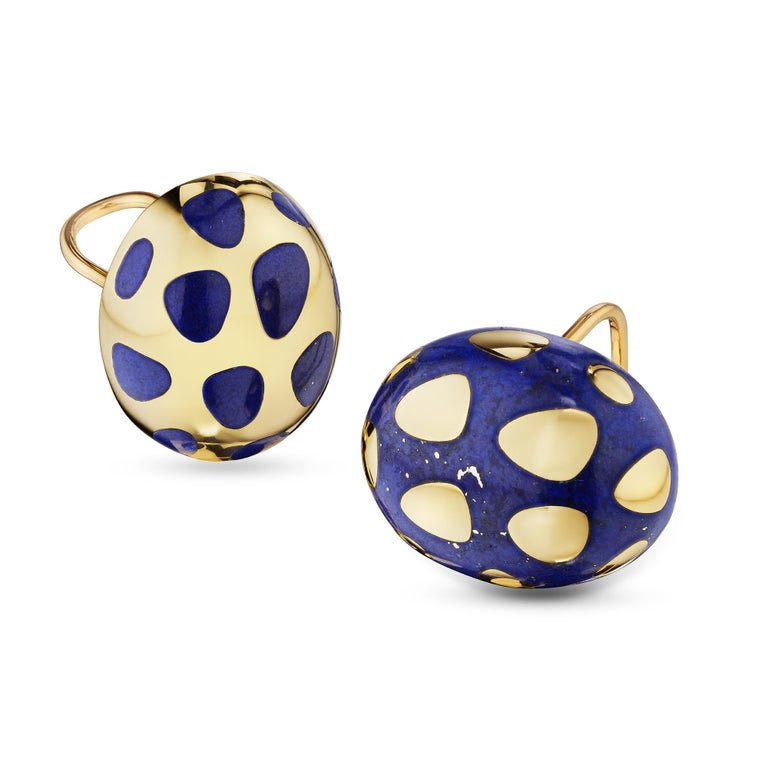 These Tiffany & Co. lapis and gold vintage earrings highlight the dualism of yin and yang and how opposite and contrary forces can be complimentary and stylishly interconnected.  With one oval shaped earring designed with a lapis background and one