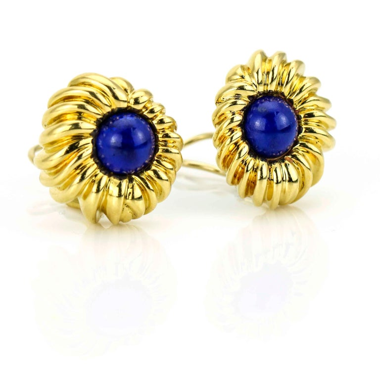 Lapis Lazuli retro earrings by Tiffany & Co. crafted in 18 karat yellow gold. Omega backs. The cabochon lapis stones have beautiful deep blue color.