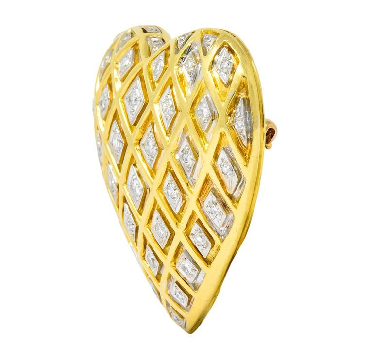 Designed as gold heart consisting of recessed harlequin pattern  With platinum mounts set with round brilliant cut and single cut diamonds weighing approximately 0.70 carat total, H to J color and VS to SI clarity (mostly VS)  Completed by fixed