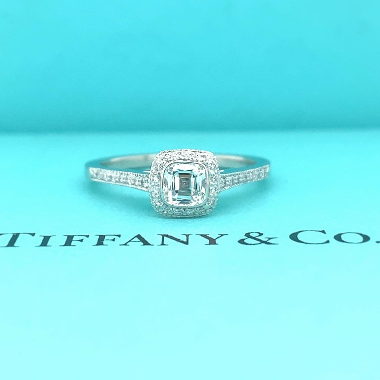 Tiffany & Co Legacy Engagement Ring Style:  Halo  Ref. number:  24200574/J03140314 Metal:  Platinum PT950 Size:  6 sizable TCW:  0.45 cts Main Diamond:  Cushion Modified Brilliant Diamond 0.35 cts Color & Clarity:  F / VVS2 Accent Diamonds:  Round