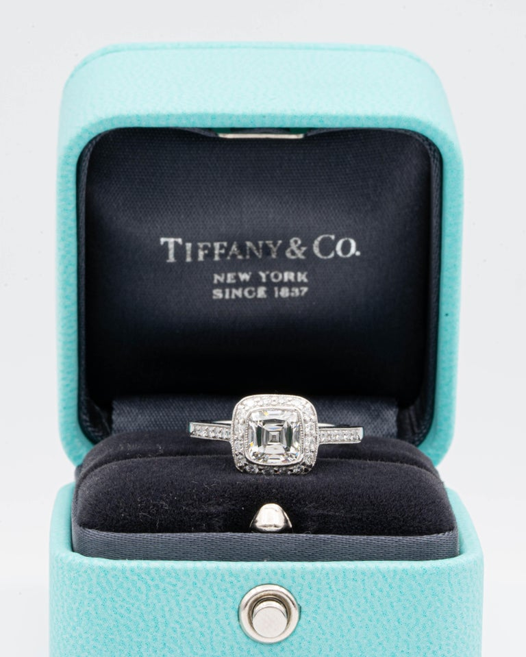 """Tiffany & Co Cushion Brilliant Engagement Ring from the """"Legacy"""" collection featuring a 1.22 carat center, G color, VS2 clarity, finely crafted in Platinum featuring dazzling bead-set diamonds in a full bezel millgrain design halo and half-way down"""