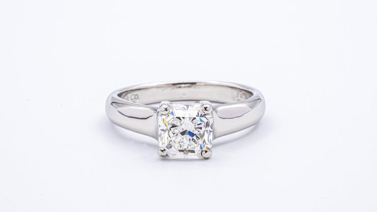 Tiffany & Co Lucida engagement ring with 1.51 carat center, E color VS2 clarity finely crafted in Platinum.   Includes certificate from The Gemological Institute of America (GIA). This ring would retail today at $32,000 ( Based on Tiffany True cut