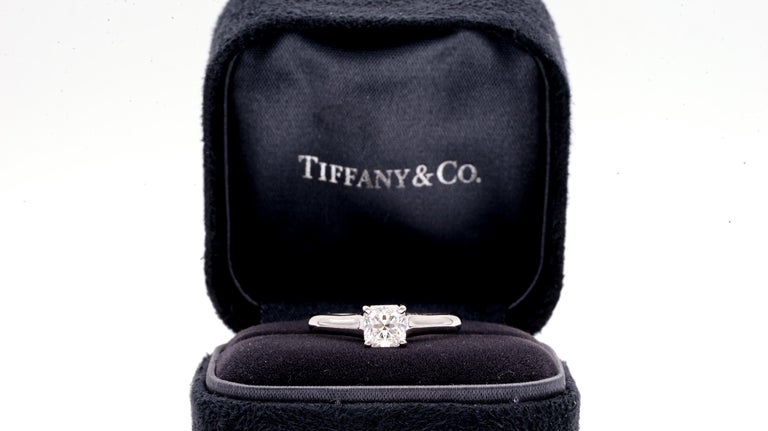 Tiffany & Co. Lucida Diamond engagement ring with 0.80 ct center , F color , VS1 clarity finely crafted in Platinum. Accompanied by Tiffany report.  Ring size is 7. Style: Lucida Solitaire  Metal: Platinum PT950   Total Carat Weight: 0.80 cts