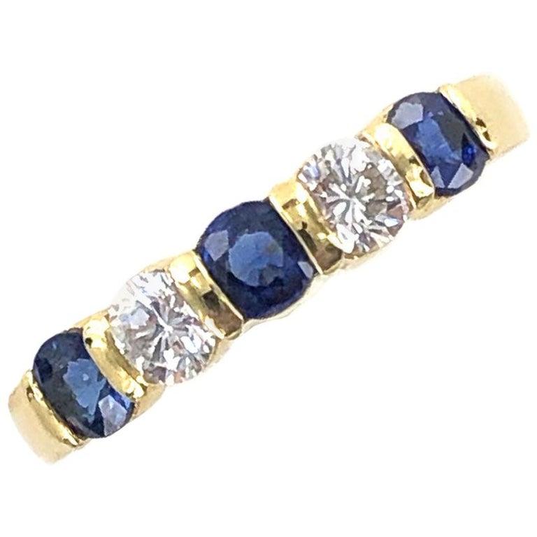 Tiffany & Co. Modern Diamond Sapphire 18 Karat Yellow Gold Band Ring For Sale