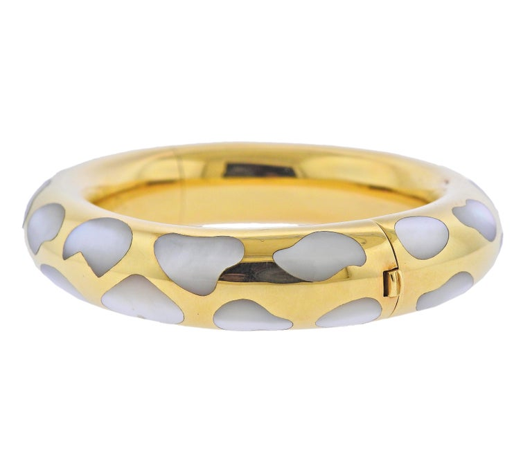 18k yellow gold bangle bracelet by Tiffany & Co, with mother of pearl inlay. Bracelet will fit up to 7.25