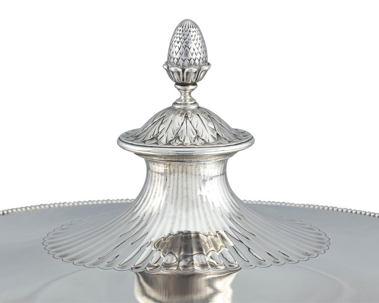 Tiffany & Co. displays its design prowess with this exquisite silver soup tureen. The firm's reinterpretation of the Neoclassical style, which was pioneered by such silversmithing legends as Paul Storr and Hester Bateman, is flawless. The footed