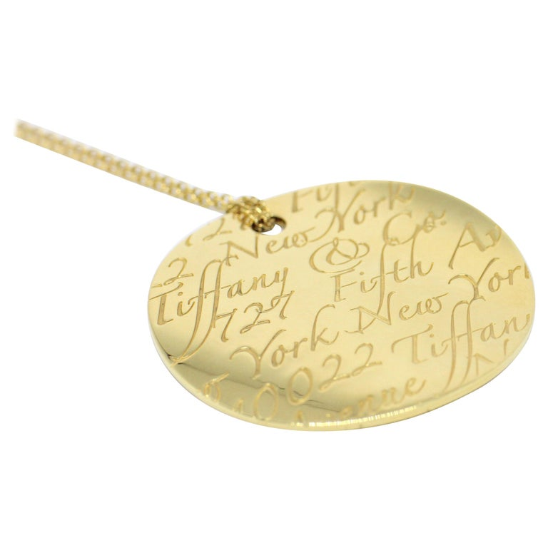 779247773 Tiffany & Co. Notes 18 Carat Yellow Gold Round Pendant Necklace For Sale