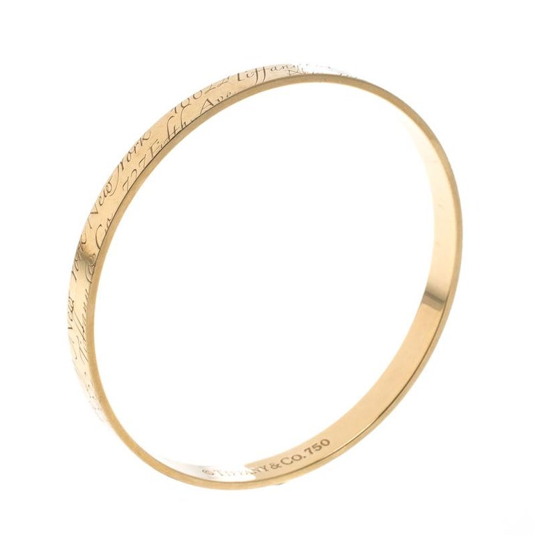 14026f863 Tiffany & Co. Notes Engraved 18k Yellow Gold Narrow Bangle Bracelet 19cm  For Sale