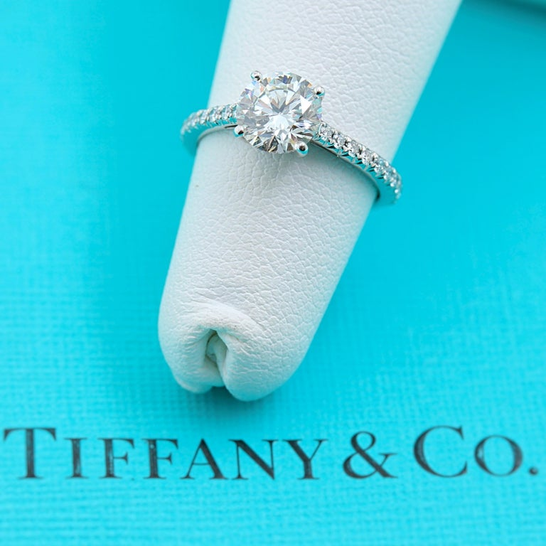 Tiffany & Co. Novo Diamond Engagement Ring   Style:  Novo Solitaire with Micro - Pave Diamonds on the Band Metal:  Platinum Size:  5 - sizable Total Carat Weight:  1.21 tcw Diamond Shape:  Round Brilliant 1.05 cts Diamond Color & Clarity:  I -