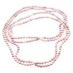 Tiffany & Co. Opera Length Strand of Pinkish Purple Pearls