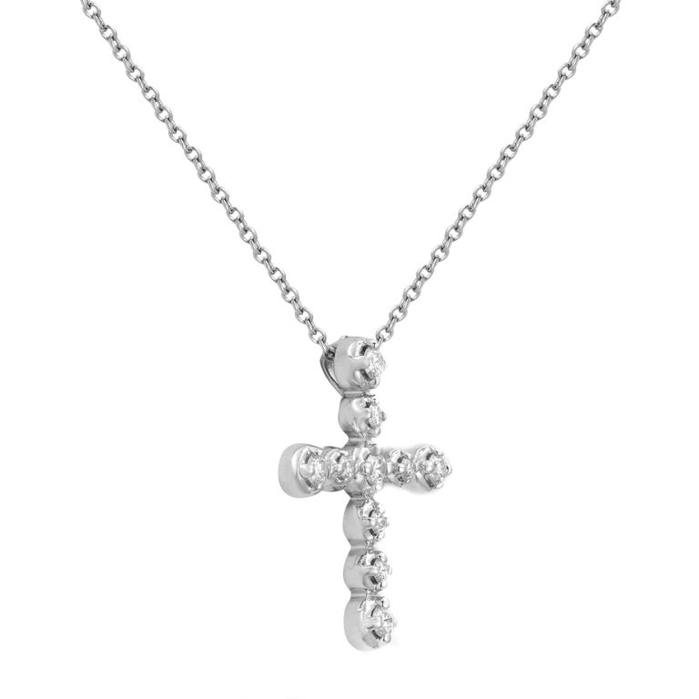 This is a gorgeous authentic cross pendant from Tiffany & Co. from Paloma Picasso collection. It is crafted from 18k white gold with a polished finish and features a lovely prong set round cut sparkling diamonds. Total carat weight, 0.30. Chain